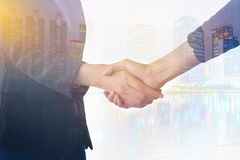 Double exposure of business handshake and business people on dea Stock Photos