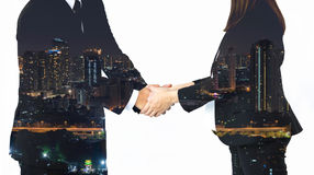Double exposure of business handshake and city. On white background Stock Images