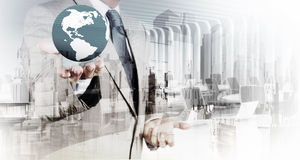 Double exposure of business  holding the earth Stock Photos