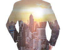 Double exposure of business man Back, looking ahead, cityscape a Stock Photos