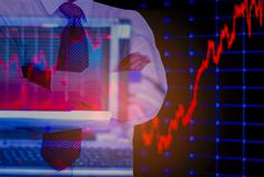 Double exposure business man, computer and stock chart as background, With concept of risk and volatility of investment world royalty free stock photo