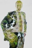 Double exposure of business man and creek in forest background Stock Images