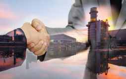 Double exposure of business man double handshake and Electric Generating Factory stock photography