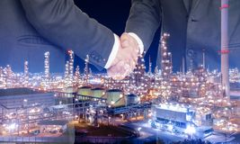 Double exposure business man hand shaking with Oil storage tank Royalty Free Stock Photo