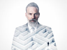 Double exposure of business man and labyrinth on. Businessman wearing modern suit and looking on the camera. Double exposure photo of the labyrinth Royalty Free Stock Photos