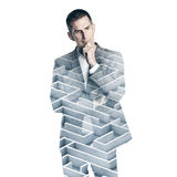 Double exposure of business man and labyrinth on royalty free stock image