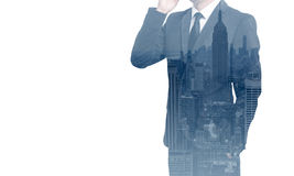 Double exposure of business man with mobile phone and city buildings background. abstract design idea Stock Photos