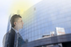 Double exposure of business man Stock Photos