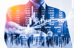 Double exposure business man on stock financial exchange. Stock Royalty Free Stock Image