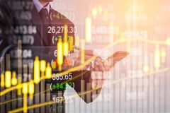 Double exposure business man on stock financial exchange. Stock Stock Images