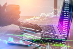 Double exposure business man on stock financial exchange. Stock. Market financial  indices on LED. Economy return earning. Stock market financial overview in Stock Photo