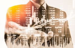 Double exposure business man on stock financial exchange. Stock Royalty Free Stock Photos