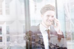 Double exposure of business man talking by phone, communication concept royalty free stock photo