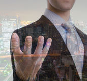 Double exposure of business man touching an imaginary screen wit Royalty Free Stock Photography
