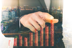 Double exposure of business man touching an imaginary screen wit Royalty Free Stock Images