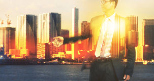 Double exposure of business man and urban office building scene Stock Photo