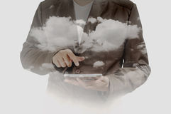 Double exposure of Business Man using Mobile Tablet PC with Clou. D and Sky as Cloud Computing or Network concept Royalty Free Stock Photos