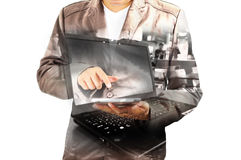 Double exposure of Business Man using Mobile Tablet PC with Note. Book or laptop computer as Wireless Technology concept Royalty Free Stock Photo