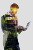 Double exposure of business man who working on laptop and alley Royalty Free Stock Photo