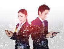 Double exposure of business man and woman using smartphone with Stock Photo
