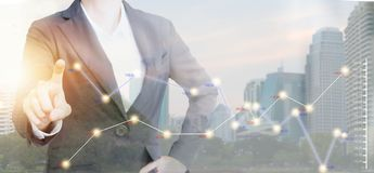 Double exposure of Business people with graph on modern city. royalty free stock image