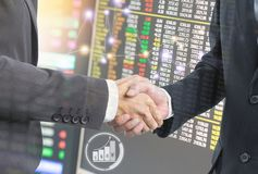 Double exposure of Business people hand shake for investment stock image