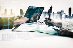 Double exposure of business people meeting to discuss the situat Stock Photo