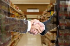 Double exposure Business people shaking hands with blurred royalty free stock photos