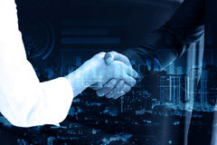 Double exposure Business people shaking hands. After closing deal in office, partnership merger and acquisition concept Stock Photography