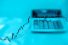 Double Exposure of Business Report calculator and investment graph with copy space Royalty Free Stock Images