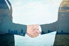 Double exposure of business shake hand stock image