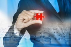 Double exposure business woman hand holding jigsaw piece with teamwork of people. Icon background Stock Photos