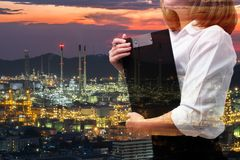 Double exposure of business woman in industry scene. Oil and power background concept stock photo