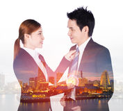 Double exposure of business woman`s hands adjusting neck tie of Royalty Free Stock Photos