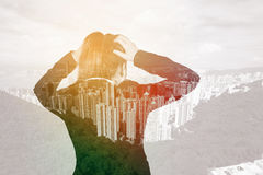 Double exposure of business woman worried with city background royalty free stock images