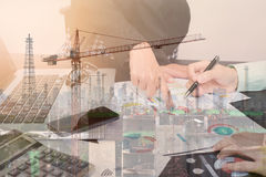 Double exposure business worker with graph finance and factory. Construction on desk office. concept plan investment Stock Images
