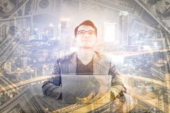 Double exposure of business working with money and cityscape at stock photos