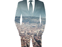 Double exposure of businessman in black suit and city Stock Images