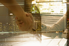 Double exposure of businessman and businesswoman handshake after Royalty Free Stock Images