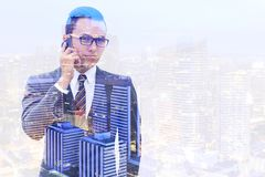 Businessman and city of night. Double exposure.Businessman and city of night stock photography