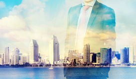 Double exposure of businessman and city skyline. Artistic concept of a businessman with city skyline in the background Royalty Free Stock Images