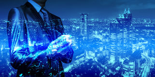 Double exposure of businessman with cityscape royalty free stock photos