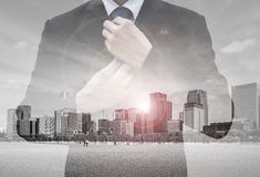 Double exposure of businessman and cityscape Stock Photography