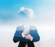 Double exposure businessman with cloud instead of head, on blue sky with silhouette mountains stock photo