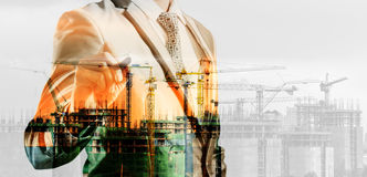 Double exposure of businessman and construction site, business c Stock Photos