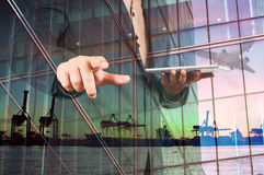 Double Exposure of Businessman with Digital Tablet and Port Carg Stock Images