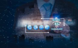 Double exposure-businessman finger touch icon 5G network wireless system,internet of things ,background city landscape and royalty free stock photos