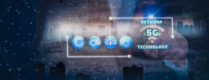 Double exposure-businessman finger touch icon 5G network wireless system internet of things ,banner background city landscape and stock illustration