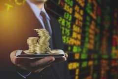 Double exposure businessman with growing stock market index grap Stock Images