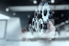 Double exposure of businessman hand show human gear to success a Royalty Free Stock Photography